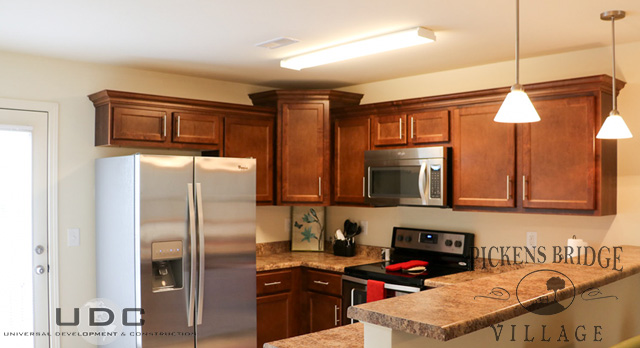 kitchen has energy efficient stainless steel appliances