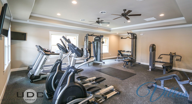 The 24-hour fitness center at The Villas at River Bend features free weights and cardio machines